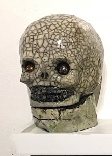 silver-and-gold-skull-rattle