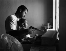 Chava (not in any gang) shows his nephew, Anthony, how to fire a ball-bearing gun.  The gun uses compressed air and lets out a big bang to which Anthony gasps. Anthony is Laffey\'s oldest son. 1994